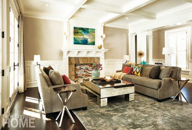 The living room was designed on a horizontal plane, with seat heights, side table, and bottom drape panels all on a similar line to give the space a more open feel.