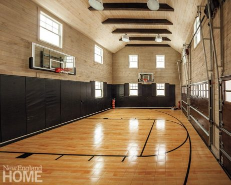 A favorite spot for Rob and the kids is the basketball court, which doubles as a three-car garage.