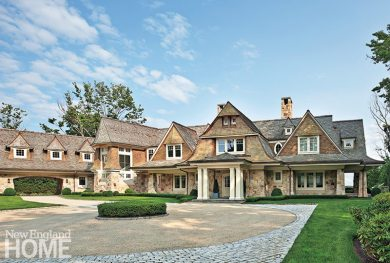 Layers of gables and a strong roofline give this coastal Connecticut home the illusion of being smaller than it actually is.