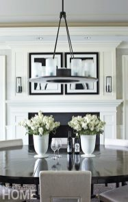 The dining room area bridges the space between the living room and the kitchen.