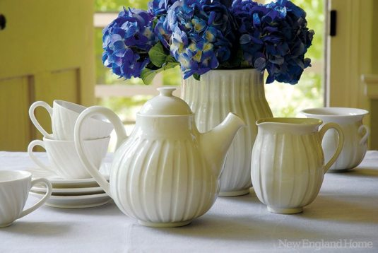 From Palmer's Pearl collection: teapot, creamer, sugar bowl, teacups and saucers and fluted vase, made of vitreous china.