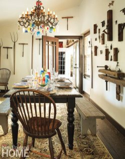 Hand-blown vases from Sea Wicks in Damariscotta, Maine, take the place of a flowery centerpiece on the dining table. The dining chairs and benches were a local find, too.
