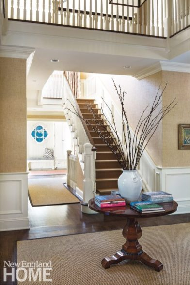 The foyer, which spans two stories, sets an airy, welcoming tone.