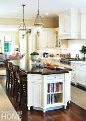 The family spends lots of time in the kitchen, often gathering at the large island with its gleaming mahogany top.