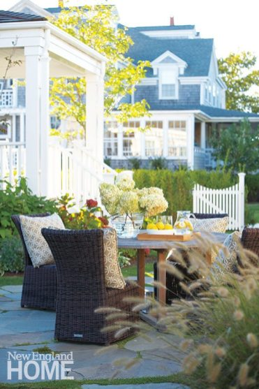 A backyard dining area has the same natural but sophisticated look as the home's interior.