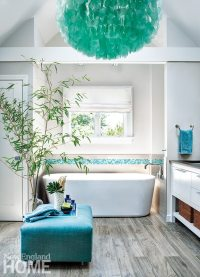 The master bath also has a tropical feel, thanks to the aqua-and-white palette and a chandelier of Indonesian capiz shells.