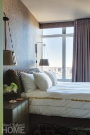 In the guest room, wall lamps from Urban Electric flank an upholstered headboard from Ligne Roset.