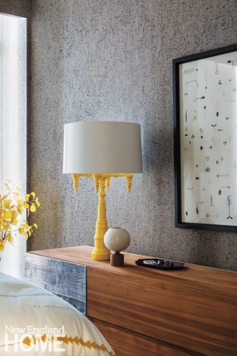 A lemon-yellow four-arm candelabrum from Dunes & Duchess in the guest room is an unexpected touch.