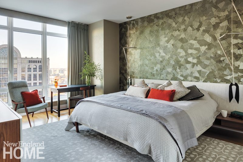 The Origami Wood wallcovering is a dynamic backdrop for the Parallel Bed with integral nightstands from Design Within Reach. The Helix pendant light fixtures are by Bec Brittain.