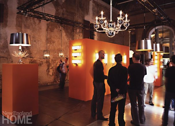 A Six Arm Silvered Glass Chandelier on display at a trade show in Paris.