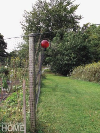 From the 2013 book After the Threshold; Red orb and fence post (2009)