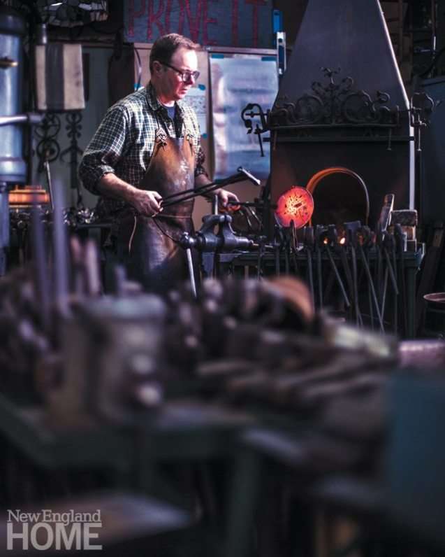 Carl Close, Jr. at work in his Newton, Massachusetts, studio; the master blacksmith made the forge as well as most of the tools he uses for his craft.