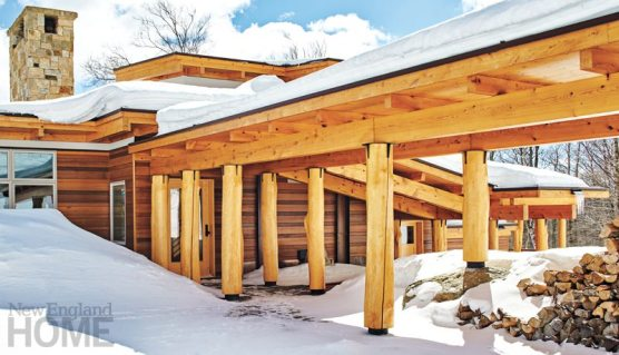 A January's worth of snow is held at bay over the entrance to this Vermont ski house, a riff on the Adirondack style designed by William Maclay Architects.