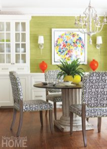 The table in the eat-in kitchen juxtaposes a distressed antique wood column base with a sleek cast-iron top.