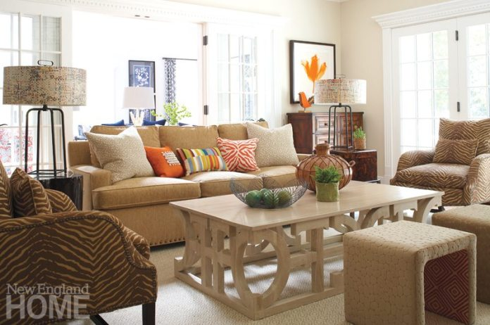 The designers incorporated indoor/outdoor fabric on the sofa and ottomans in the TV room, making them family- and pet-friendly.