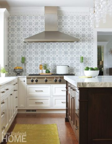 The Carrara- and Thassos-marble backsplash in a soft gray-and-white pattern lends a wow factor to the kitchen.