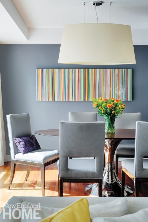 A painting by Michael Hoffman adds a spark of color to the dining area.