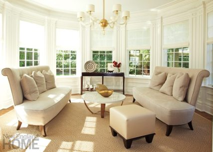 The living room features seating design by Scalo.