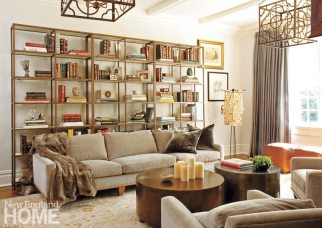In the family room, Julian Chichester shelves provide a home for a growing collection of books and mementoes. In addition to providing light, the stylish metal lanterns hanging from the ceiling help unify the space.