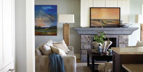 The living room's welcoming furnishings complement the nature-inspired palette devised by THT Interior Design.