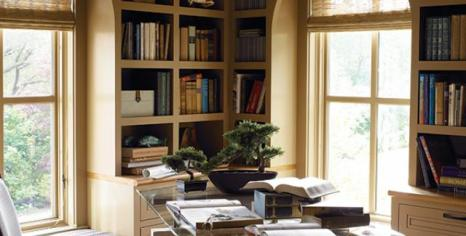 High-caliber woodworking, including a coffered ceiling, creates an extraordinarily appealing study.