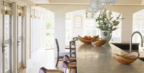 The kitchen, dining room and sun room spill seamlessly into each other, promoting congenial summer living.