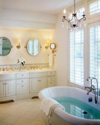 The master bath has wave-like tile conjures sea thoughts. Radiant heat ensures coziness.