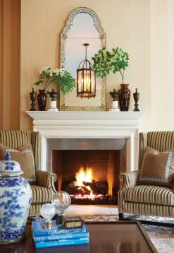 A hand-painted mirror adorns the living room mantel.