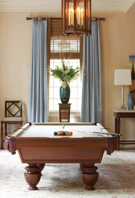 The living room is meant for entertaining, with a built in bar and a billiard table.
