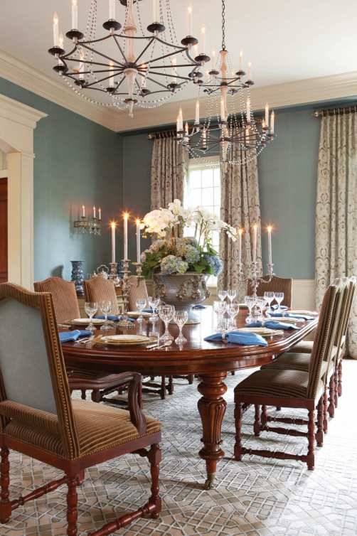 In contrast to the silk wallcovering, dining room curtains sport simple rings and poles.