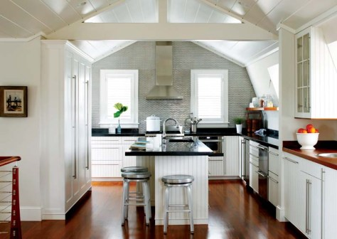 The kitchen's walls and ceiling follow the gambrel roofline.