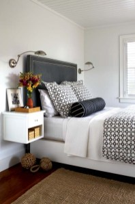 Hay also designed the guest room's gray Ultrasuede headboard and floating bedside tables.