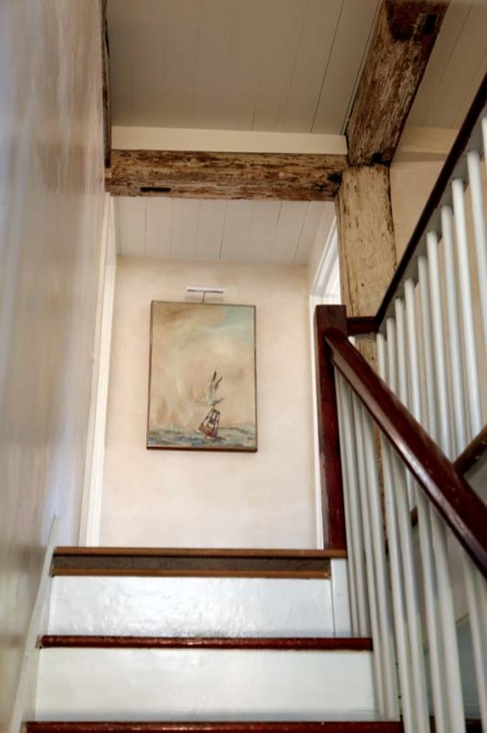 Original timbers on display in the stairway.