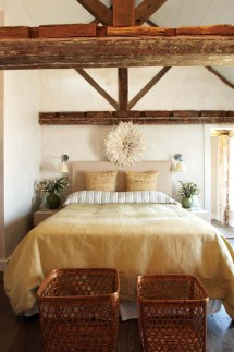 In the master bedroom, the ceiling was taken down to reveal the timbers and give the room more height.