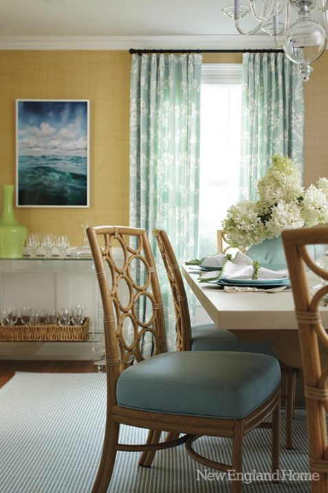 Turquoise touches run throughout the house from plates to upholstery and curtain fabrics.