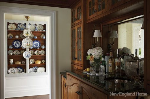 A reclaimed chestnut interior and new white cabinetry bring stature to the hallway niche that is now the butler's pantry.