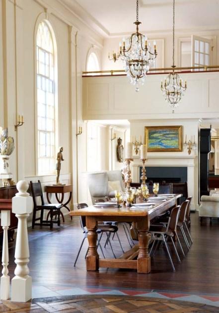 Midcentury modern Castelli chairs join a massive eighteenth-century English oak dining table.