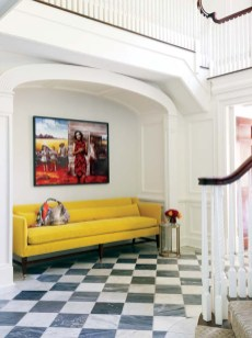 A sunny yellow sofa and a painting by Australian artist Tracey Moffatt warm the foyer'€™s niche.