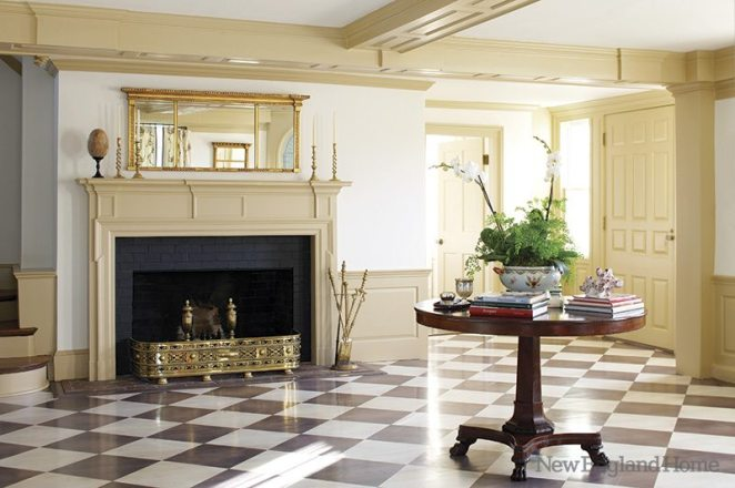An antique Federal mirror lends grace to the entry hearth.
