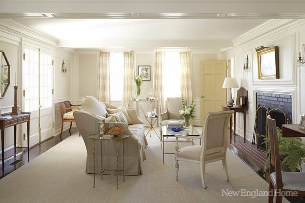 Walls painted Benjamin Moore Cloud White complement the living room's pale furnishings.