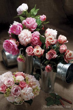 A popular combination, pink and cream roses marry well with peonies.