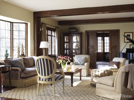 A new diamond-pattern rug from Nepal in the living room forms a transitional backdrop for the homeowners' favorite, more traditional, furniture from previous houses.