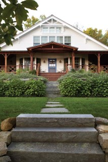 Asian-inspired fretwork and bracketing on the exterior invoke waterfront cottages from the Victorian era.