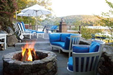 Dean turned the dock area into a place to entertain, with a fire pit and hidden storage.