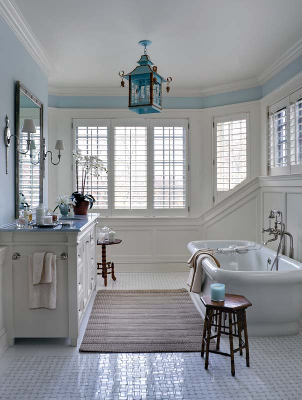 One of two master bathrooms, this boasts a light gray-and-white basket weave tile floor.