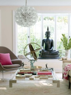 A Buddha gazes over the living room where antiques mix with new pieces.