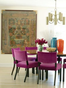 Gallipoli found the 300-year-old Tibetan thangka in a junk shop. The fuchsia mohair on the chairs is by Kravet.