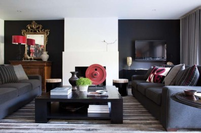 The living room is filled with wares from the designer's shop, such as the dueling sofas covered in Italian cashmere, stools from the Philippines and a Belgian rug.