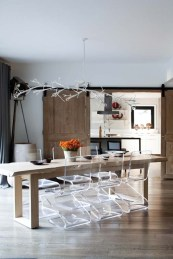 A wire-and-plaster chandelier illuminates the dining table.