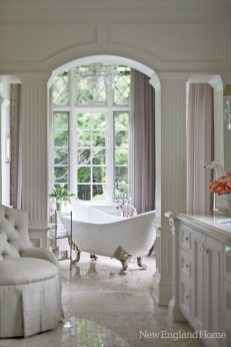The tub in the wife's bathroom sits in its own niche overlooking the grounds.